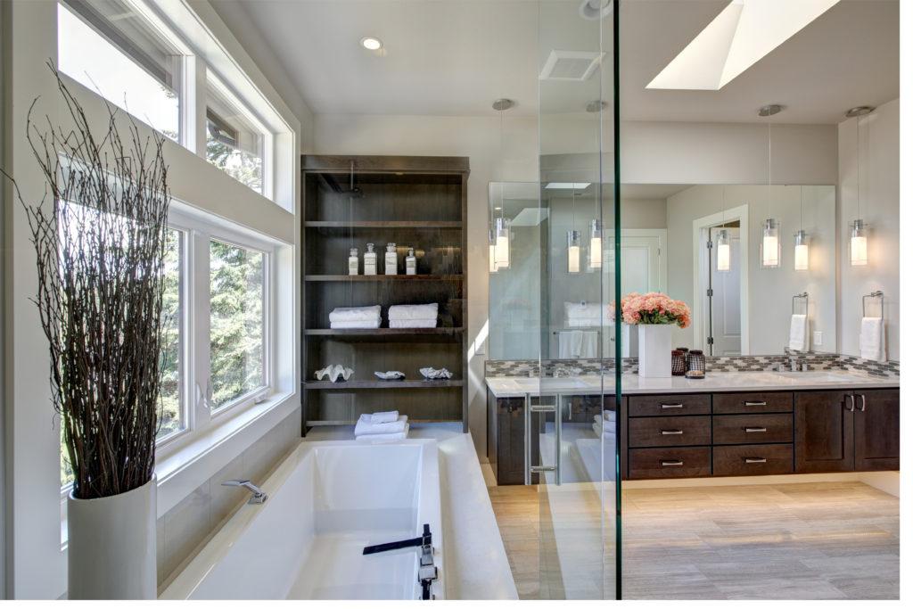 modern bathroom with natural lighting and pendant lighting